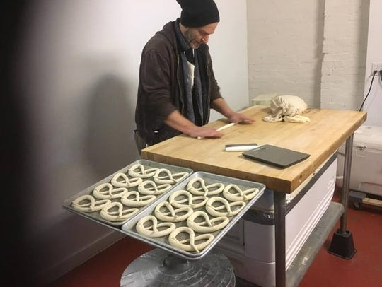 Eddy Schoeffmann of Blunt Pretzels demonstrates how to roll out a pretzel.