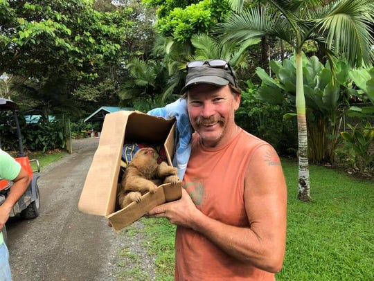 Dirk Morgan, a Cincinnati native who owns Morgan's Canoe and Outdoor Adventures in Oregonia, Ohio, holds the sloth he and his wife came across in Costa Rica.