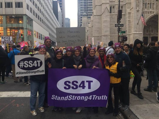 "Denise Migliaccio, far left, with her husband and the group she marched with in New York City. Migliaccio said they chanted, ""We're Marching, We're Powerful, We Stand Strong 4 Truth!"""