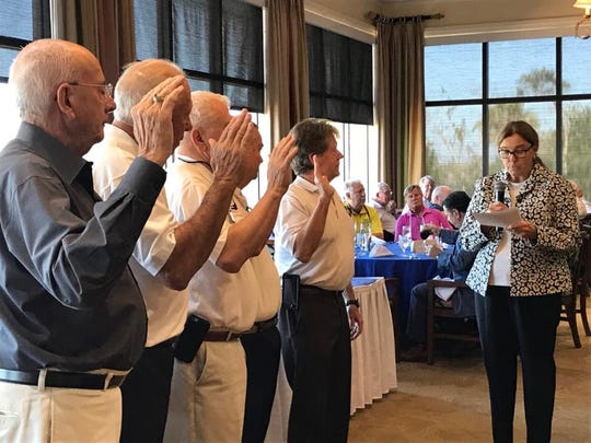 "Marco Island City Council Vice-Chair and former U.S. Army garrison commander Charlette Roman swears in new police officers during the Marco Island Police Foundation's ""Lunch with the Chief"" event on January 16, 2018."
