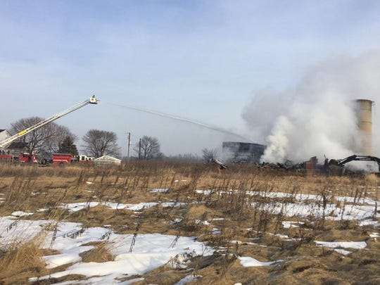 Fire crews worked to get a barn fire under control