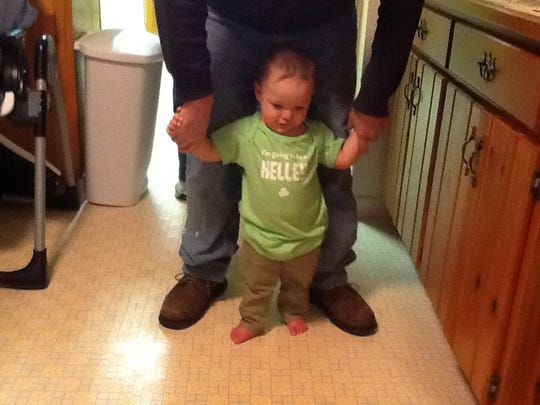 Daniel Kelley Jr., helping his grandson, James Daniel Kelley, walk.