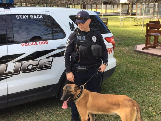 Port St. Lucie police Officer Will Harris and Bodhi