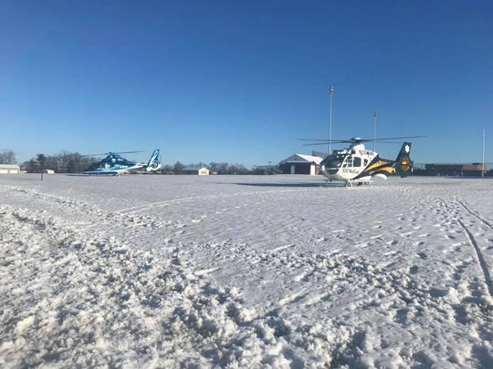 Two helicopters land to transport two people to area trauma centers after they were struck by a vehicle in New Oxford Borough on February, 5, 2018.