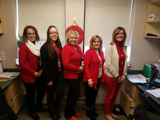 Members of UHS Cardiology don red on 'Wear Red Day.'