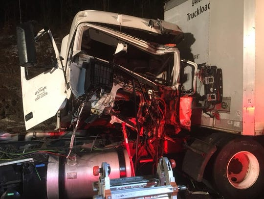 The wreckage of a tractor-trailer after a major crash