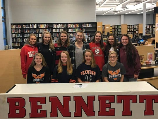 Teammates and friends surround Hannah Dickson as she announces her intent to play softball at Keystone College.