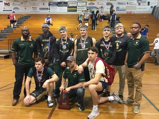 Lincoln's wrestling team celebrates its six state qualifiers