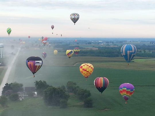 """Last Lap"" floats above other balloons at the National Balloon Classic in Indianola, Iowa."