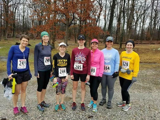 Fayetteville's Amy Whitmoyer (285), poses for a photo with friends before the start of last weekend's Squirrelly Tail Twail Wun, a half marathon race at Gifford Pinchot State Park.
