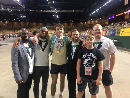 Lincoln wrestling coaches, including new National Wrestling