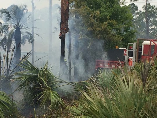 Firefighters battle a fast-moving brush fire Saturday