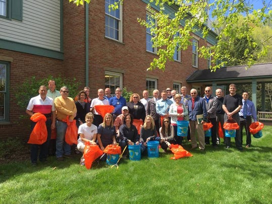 Members of the Coshocton Rotary Club clean-up Lake Park during a meeting in 2017. Front row are Daphne France, Valerie Miller, Heather Guess, Amy Hasseman, Dr. Danielle Erwin and Tom Edwards, kneeling. Second row are Steve Fox, Bill Brown, Sharon Sutton, Dr. Jere Butcher, Dale Sutton, Jamie Crawford, Dr. David Erwin, Tim Vance, Shelley Lillibridge, Gordon Spillman, Doug Marmie, Dr. Don Tupper, Dr. Brad Arndt and Jason Hammond. In the back are Jeff Eikenberry, Jim Brown, Tim France, Steve Clark, Todd Endsley, Eric Taggart and Curt Crouso.