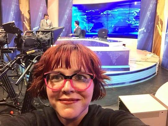 Abbey Doyle takes a selfie on a Pakistani television set.
