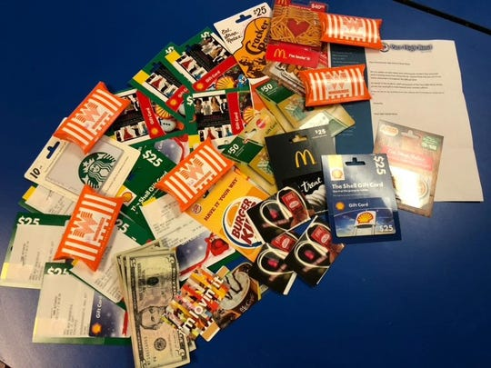 A pile of gift cards and cash collected by Pace High