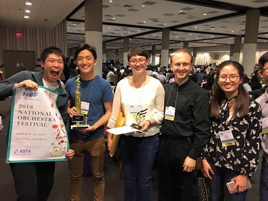 Celebrating a winning trip by the Knoxville Symphony Youth Orchestra, from left, are Eric Zhang, Daniel Choo, Renae Dishman, Maestro James Fellenbaum and Alissa Nam.
