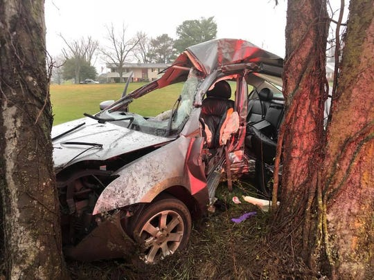 Carrie Fitzgerald, a Rutherford County Emergency Medical Services dispatcher, helped save the life of the driver of this car, which crashed into a tree during a rainstorm last weekend near the intersection of Rucker Lane and Confederate Road in Murfreesboro.
