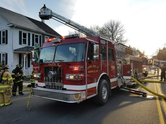 Emergency crews fight a fire in a second floor bedroom at 428 E. Main St., Annville, on Monday, March 19, 2018. The fire was mostly contained to the bedroom, but the house sustained considerable smoke damage.