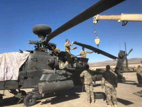 Maintenance soldiers with Delta Troop, 3-6 Cav remain prepared to repair and maintain the unit's Apache helicopters even in the most austere conditions such as the National Training Center at Fort Irwin, Calif.