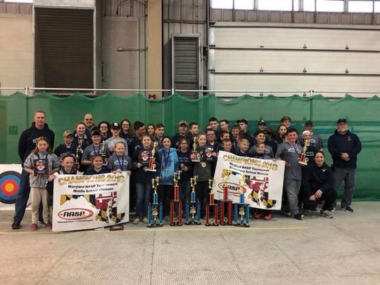 The Holly Grove archery team poses after its 2018 state