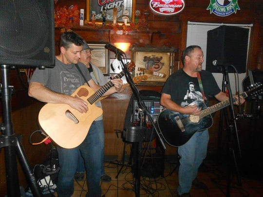 Ivan Flanscha, left, plays with his band RoadTrip at The Valley Tavern in Seven Valleys in 2013. Flanscha, a York firefighter, was killed in a building collapse March 22, 2018.