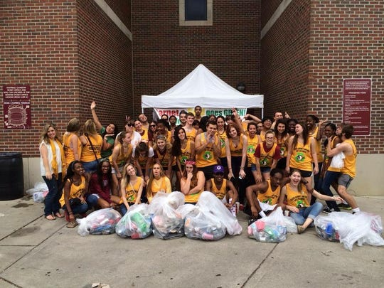 Garnet and Gold goes green as student volunteers assisting football tailgaters recycle.