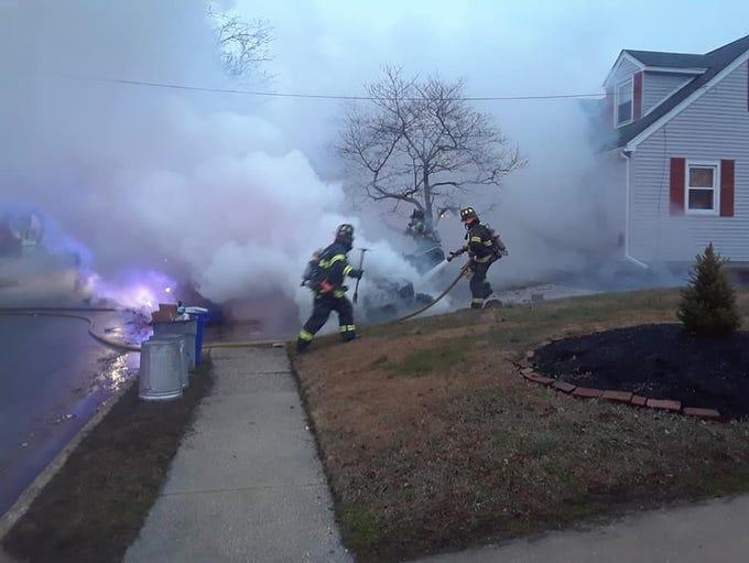 Gloucester City fire crews fight a car fire on Walnut