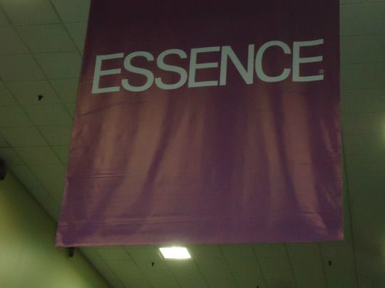 An Essence Festival banner hangs from the ceiling during