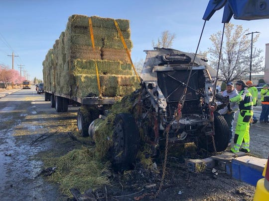 Crews clean up a hay truck fire near Gardnerville on
