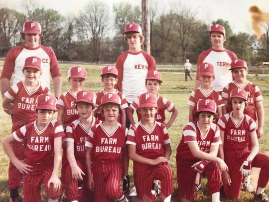 Craig Shoobridge, fourth from left in the front row, during his Little League days in Petersburg, Indiana. His dad Vince, a bricklayer, is the coach to the far left in back.