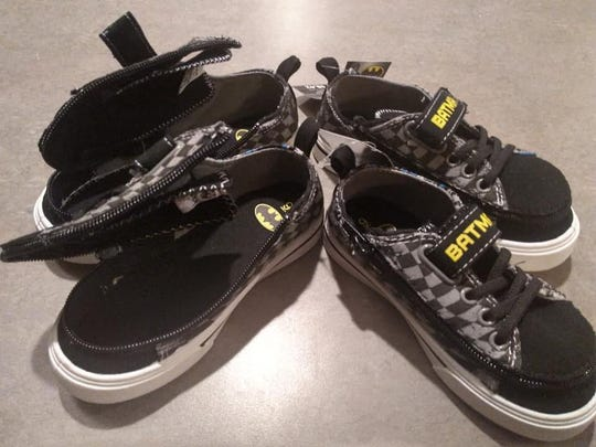 Batman sneakers Jill Glidden, of Sweden, modified for the sons of Chris Muller, of Chili. The children wear braces on their feet which make traditional sneakers challenging to take on and off.