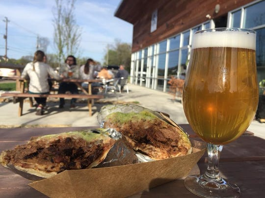 Beer and a food truck meal on the patio at Alliance.