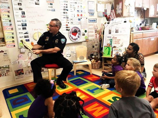 Vero Beach Chief of Police David Currey reads to a