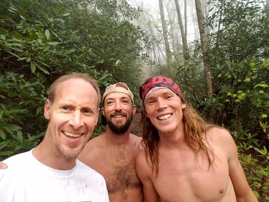 Morgan Elliott, right, stops for a photo with Black Mountain runners Adam Hill and Paul Scouten while the trio goes for a run in Montreat.