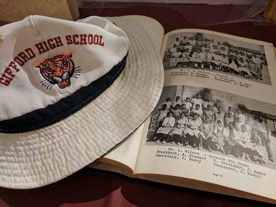 A hat and copy of the Gifford High School yearbook.