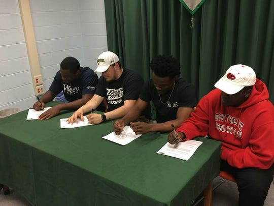 L-R: Tyler Poulson, Brandon Burkhardt, Nayel Oge and Ernest Ayieko announce their intent to play football at the college level.