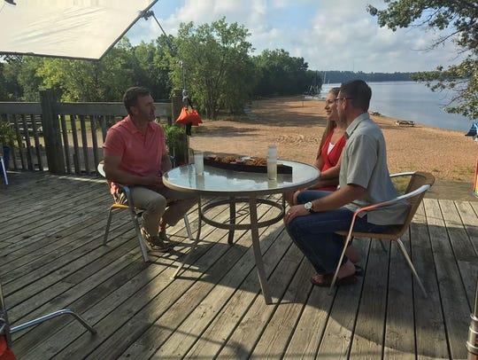 Brad Pavloski talks with Aaron and Brenda Cordy during