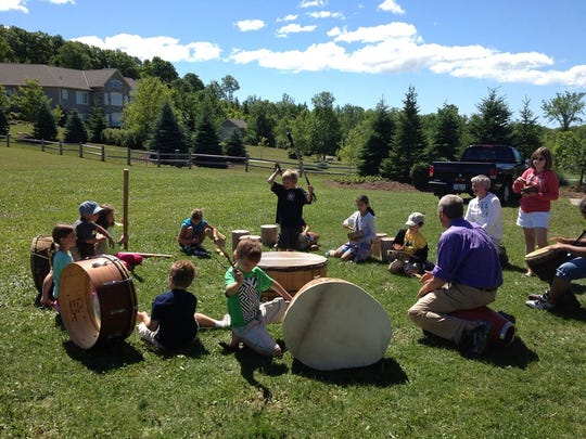 """Children make some noise in """"The Beat and Beyond,"""" a drum-making and drum circle program that's one of the offerings in """"Art on the Wild Side."""""""