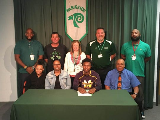 Parkside High School senior Jalen Deloach announces his intent to play basketball at Morris College on Monday, surrounded by his family and coaches.