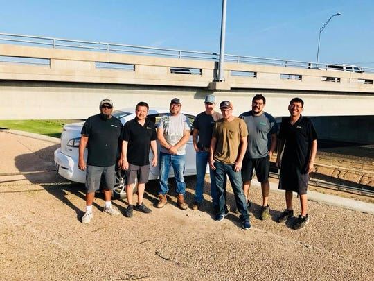 San Angelo Police hailed these seven citizens as 'heroes' after they saw a car dangling from the overpass off loop 306 and rushed in to save its occupants. June 1, 2018.