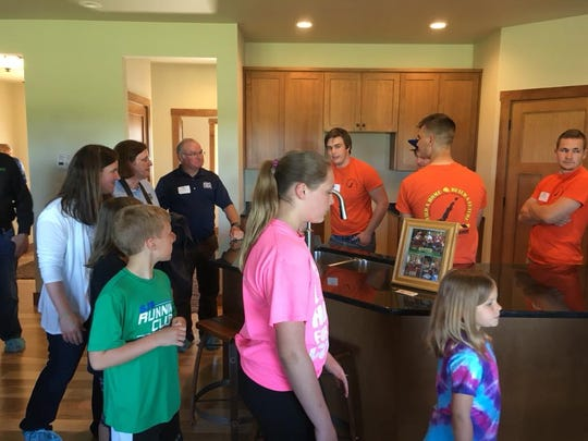 Families and community members toured the house build