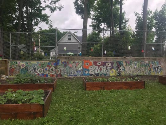 A new mosaic flanks the garden at West Middle School.