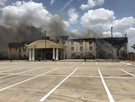 A fire destroyed a Holiday Inn Express on US Highway