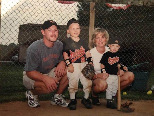 Sean, Evan, Alison and Brenan Hanifee in July 2000 on the field Sean Hanifee built.