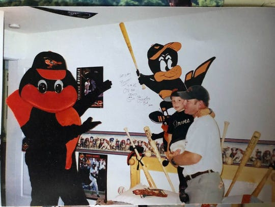 Sean and Brenan Hanifee watch at the Orioles' mascot