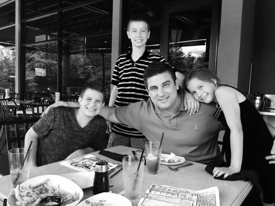 Drew Sullivan and sons, Lawson and Fin, and daughter, Arden.