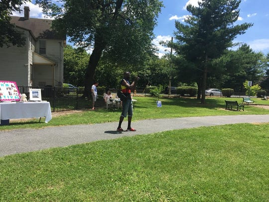 A man takes photos of Salisbury's Juneteenth celebration