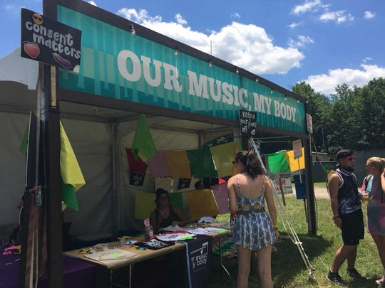 People stopped by to chat with the OurMusicMyBody organizers near the main Firefly Stage on Friday.
