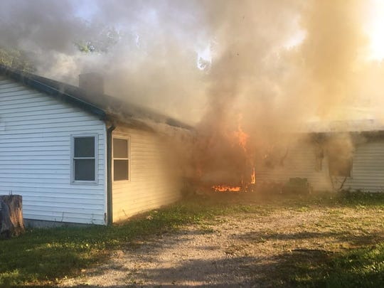 A West Knox County woman has escaped after she told authorities an intruder bound her with duct tape and set fire to her home.