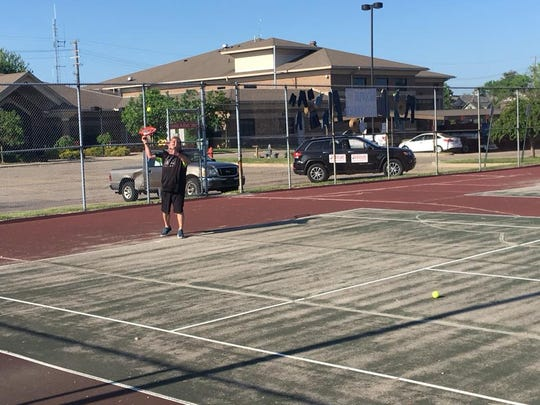 Paul Zyburski posted this photo on Facebook of him playing tennis in Fraser.